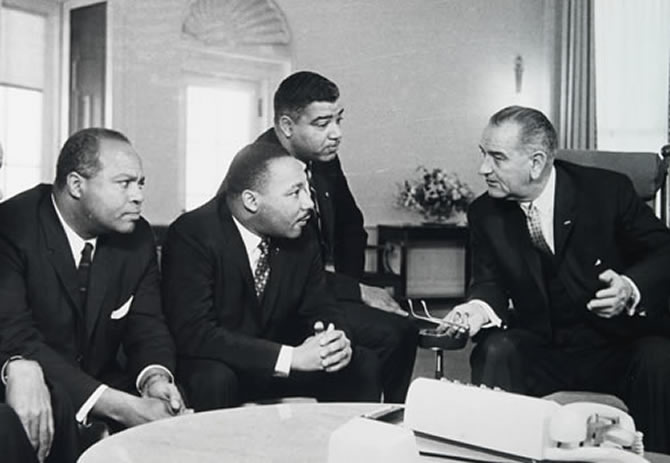 President Lyndon Johnson speaking with civil rights leaders.